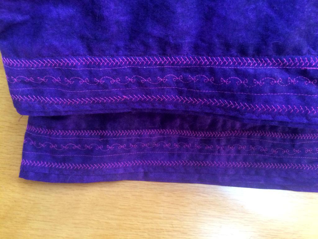 purple pillows decorative stitching