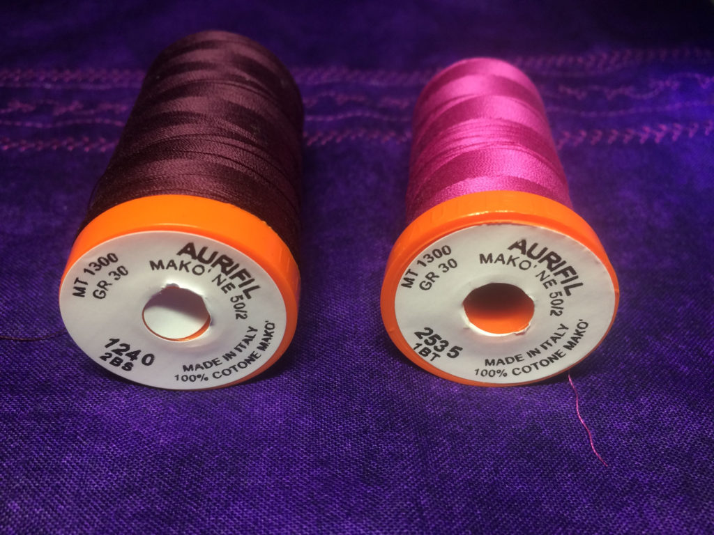 purple pillows sewing threads
