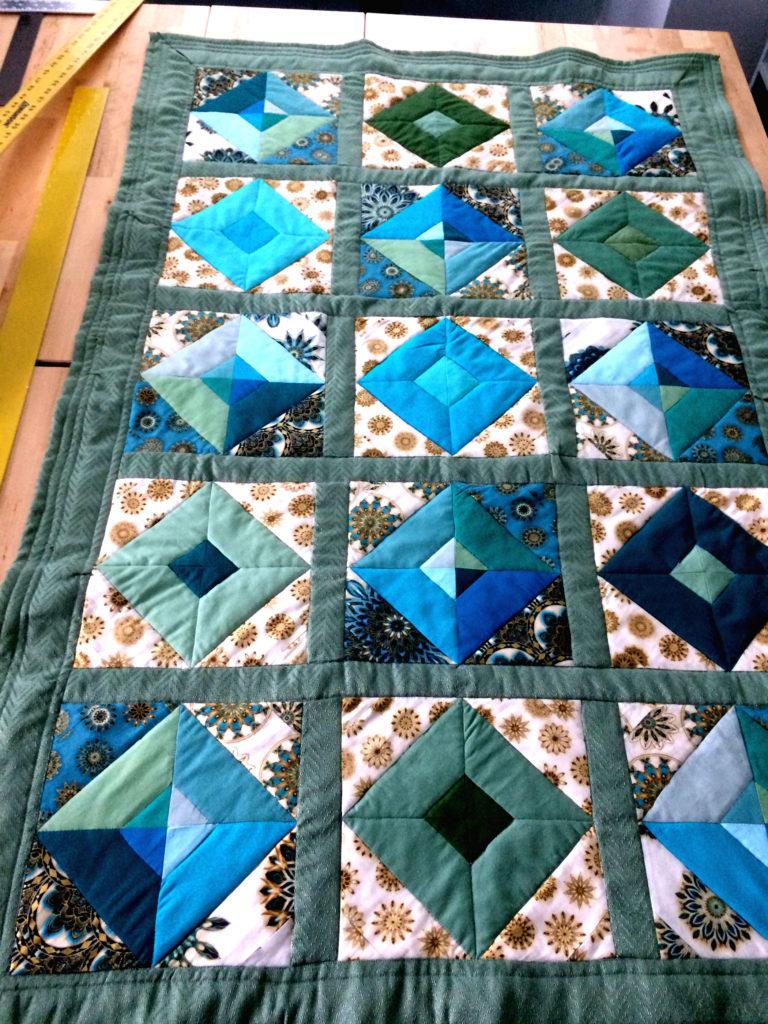 Sage color lap size quilt