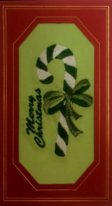 candy cane in a bow for Christmas card