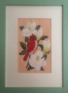 cardinal with magnolias