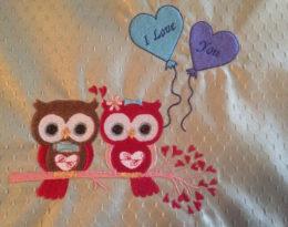 Owls in loves on light green table mat