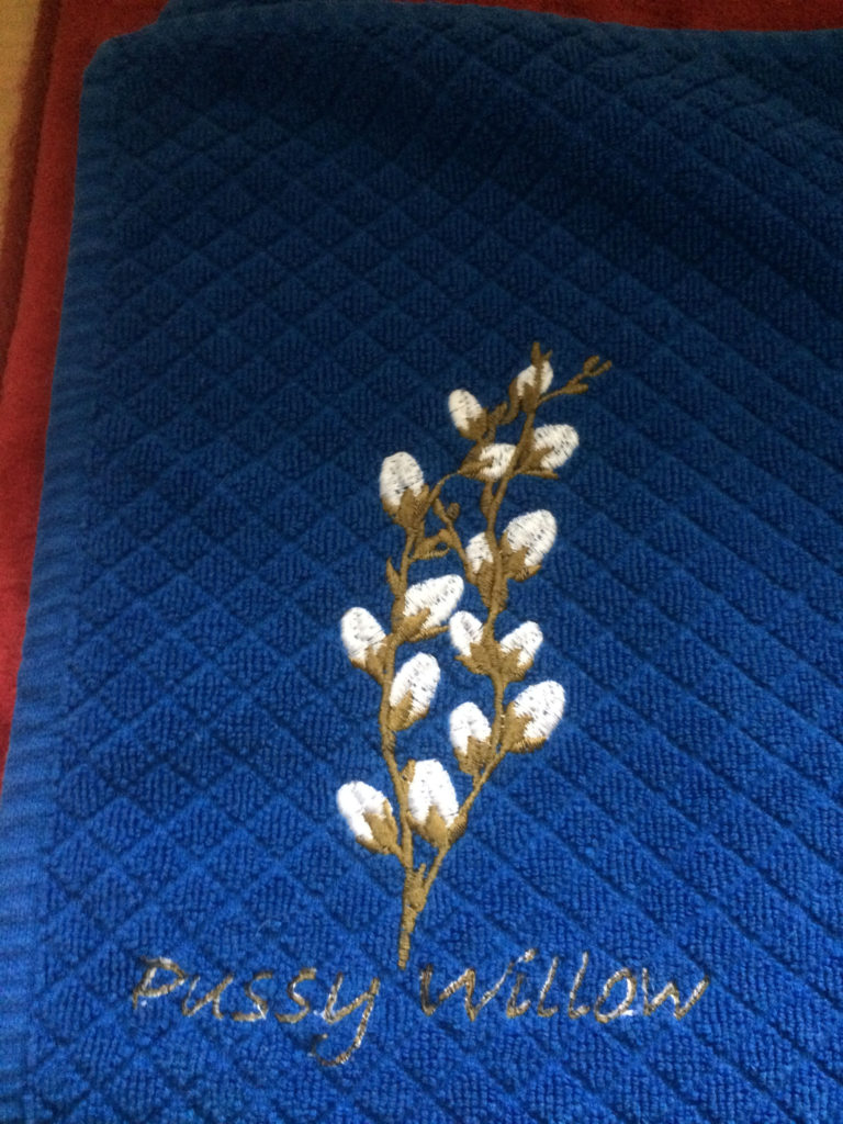 pussywillow on dark blue kitchen towel