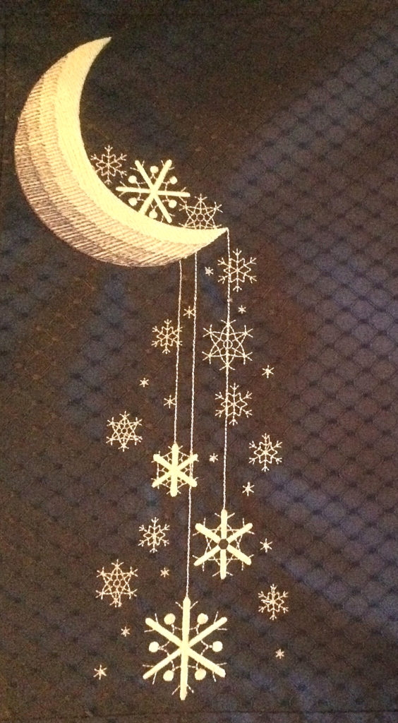 Starry snowflakes on dark blue table mat
